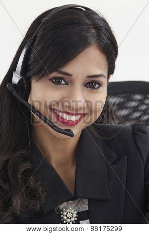 beautiful receptionist wearing head set talking