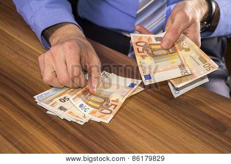 Businessman Counts Euro Money