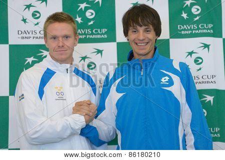 DNEPROPETROVSK, UKRAINE - APRIL 4, 2013: Markus Eriksson, Sweden (left) and Denis Molchanov, Ukraine before Davis Cup match Ukraine vs Sweden. Ukraine won the match 3-2