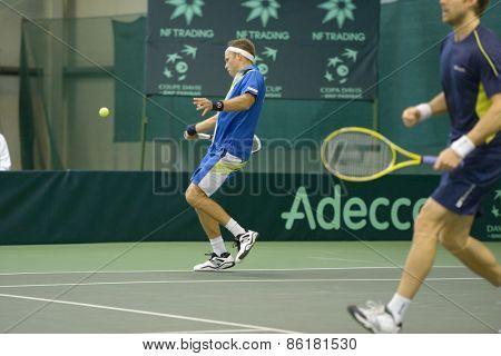 DNEPROPETROVSK, UKRAINE - APRIL 6, 2013: Robert Lindstedt (left) and Johan Brunstrom, Sweden in the Davis Cup match Ukraine vs Sweden. Ukraine won the match 3-2