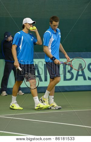 DNEPROPETROVSK, UKRAINE - APRIL 6, 2013: Sergey Stakhovsky (right) and Denis Molchanov, Ukraine in the Davis Cup match Ukraine vs Sweden. Ukraine won the match 3-2