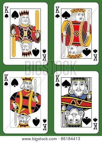 Four Kings of Spades in four different styles on a green background