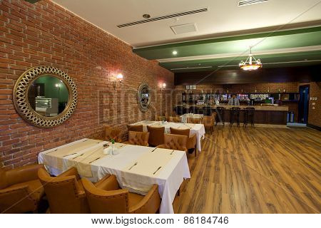 Luxury interior of a restaurant in a hotel, during evening.