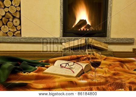 The fireplace and the book