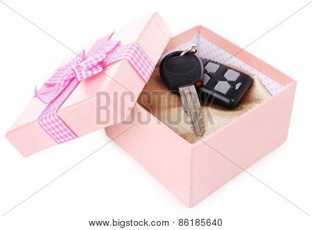 Car keys in present box isolated on white