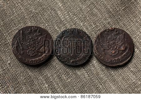 three copper coins