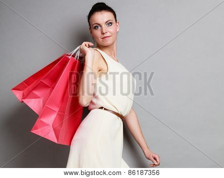 Woman Holding Red Paper Shopping Bags