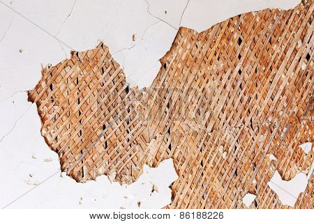 Old Damaged Vintage Destroy The Wall With Cracks, Scratches, Wooden Slats. Requires Urgent Repairs.