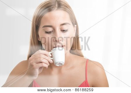 Woman Drinking An Espresso At A Coffee Shop