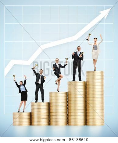 Business people with golden cups on coins ladder.Concept of professional growth