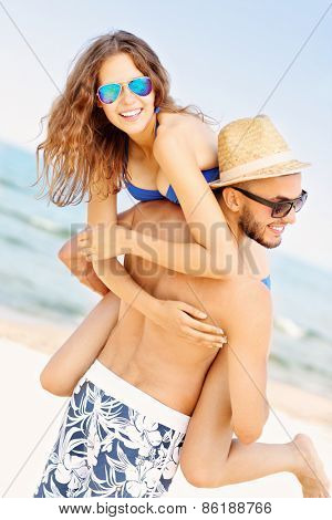 A picture of a young couple having fun at the beach in the summer