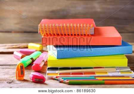 Bright school stationery on old wooden table