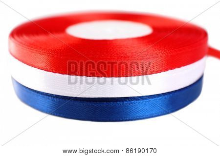 Colorful rolled ribbons on white background