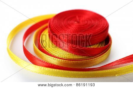 Colorful red and yellow ribbons isolated on white