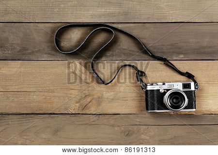 Retro camera on wooden planks background