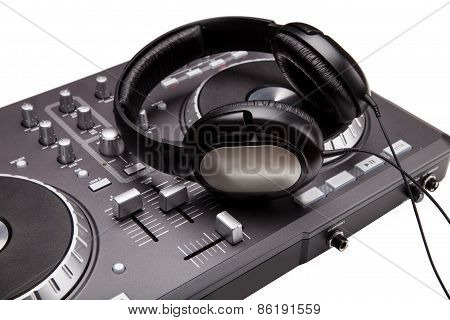 Dj mixer with headphones isolated on white background