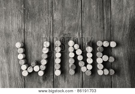 Wine corks on wooden background in shades of grey