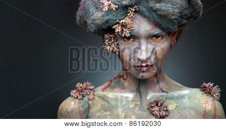 Portrait of young beautiful woman with fancy make-up and vintage flowers.