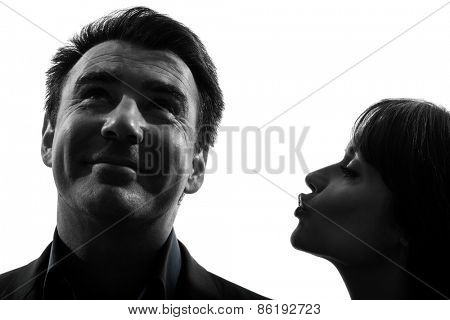 one  couple woman kissing man in silhouette studio isolated on white background