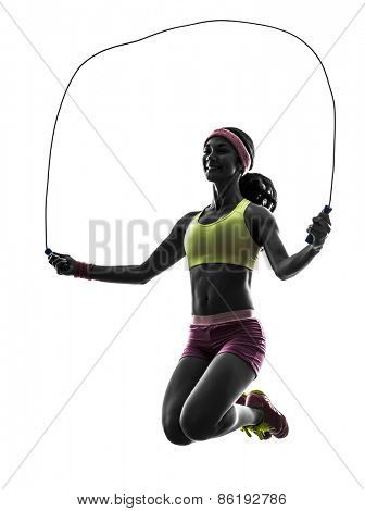 one  woman exercising fitness jumping rope in silhouette on white background