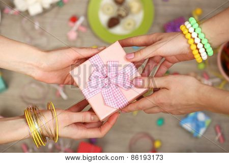 Female hands holding gift close-up