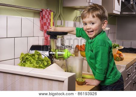 Happy Toddler Making Green Juice