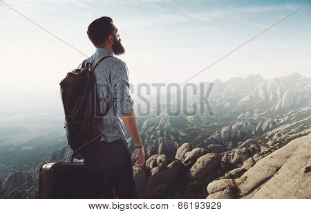 Bearded Hipster Lookig At Mountain