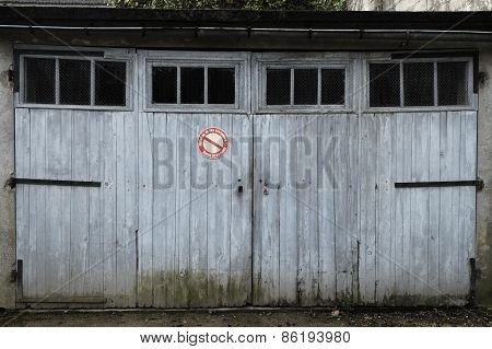 Garage With Weathered White Doors