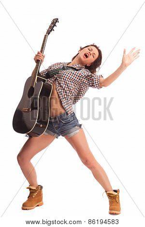 Beautiful woman playing in guitar