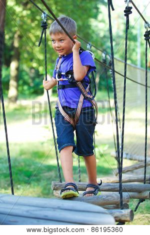 Boy in a climbing adventure park