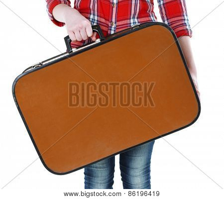 Woman holding old suitcase isolated on white