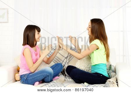 Two girls smiling on home interior background