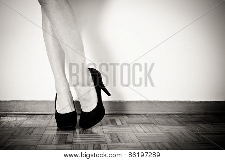 Young Sexy Woman Feet With Black High Heels And Legs, Close Up