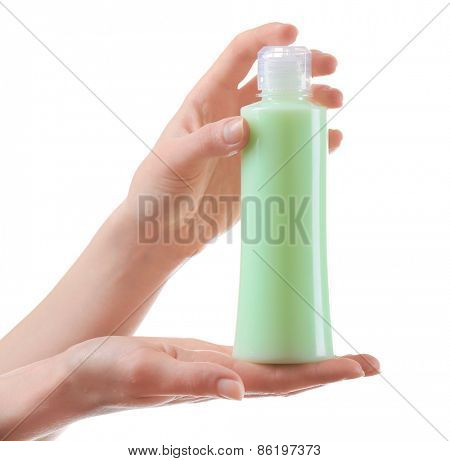Female hands with cosmetics bottle isolated on white