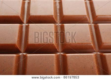 Milk chocolate bar close up