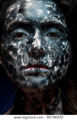 Portrait of a mysterious woman with a fantastic makeup Alien