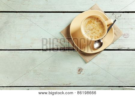 Cup of cocoa on color wooden planks background