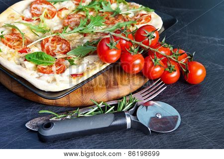 Delicious fresh pizza on dark