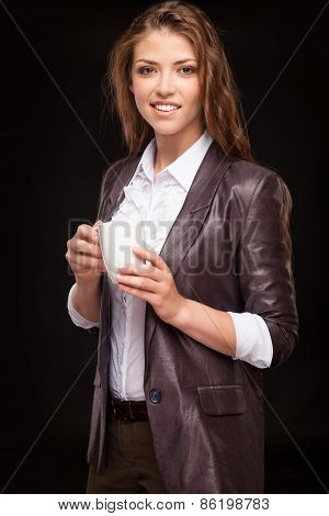 Woman enjoying a large cup of freshly brewed hot tea
