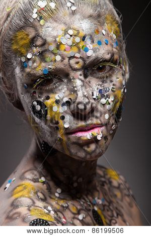 Portrait of a beautiful alien lady with an unusual make up