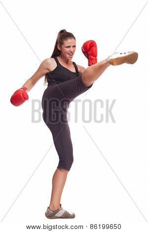 Boxer woman. Boxing fitness woman smiling happy wearing red boxing gloves.