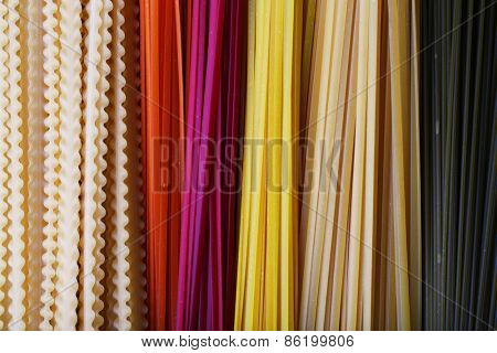 Different types of colorful pasta, macro view