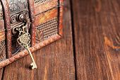 foto of treasure chest  - vintage key and old treasure chest on wooden table - JPG