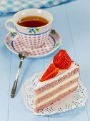 stock photo of time-piece  - A piece of strawberry cake with a cup of tea - JPG