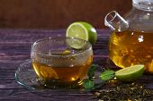 image of mint leaf  - Tea fresh fragrant tasty appetizing to drink hot invigorating tea leaves a teapot glass transparent drops a cup a saucer warm lime juicy green health a peel pulp mint fragrant leaves a table wooden - JPG