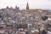 Photo of toledo skyline view at sunset with cathedral. Spain.