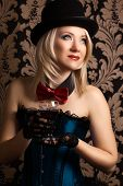 picture of cabaret  - beautiful cabaret woman holding a glass of red wine against retro wallpapers - JPG