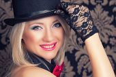 picture of cabaret  - beautiful cabaret woman posing against retro wallpapers - JPG