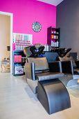 stock photo of beauty salon interior  - Closeup of washing head seat inside of empty modern hair and beauty salon - JPG