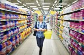 foto of supermarket  - The women shopping in supermarket with basket - JPG